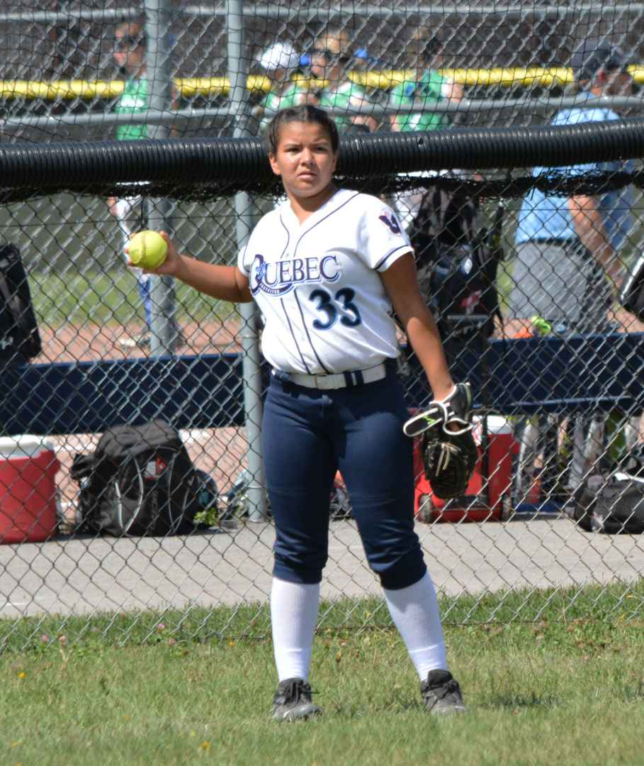 Kahnawake's own Raven Horn warms up betwwen innings before her team the Quebec Rebelles beat the Alberta's Lloydminster Liners 6-1 in a fastpitch softball game at parc Marcel-Martin last Wednesday August 17th. (Kacim Steets 2016)