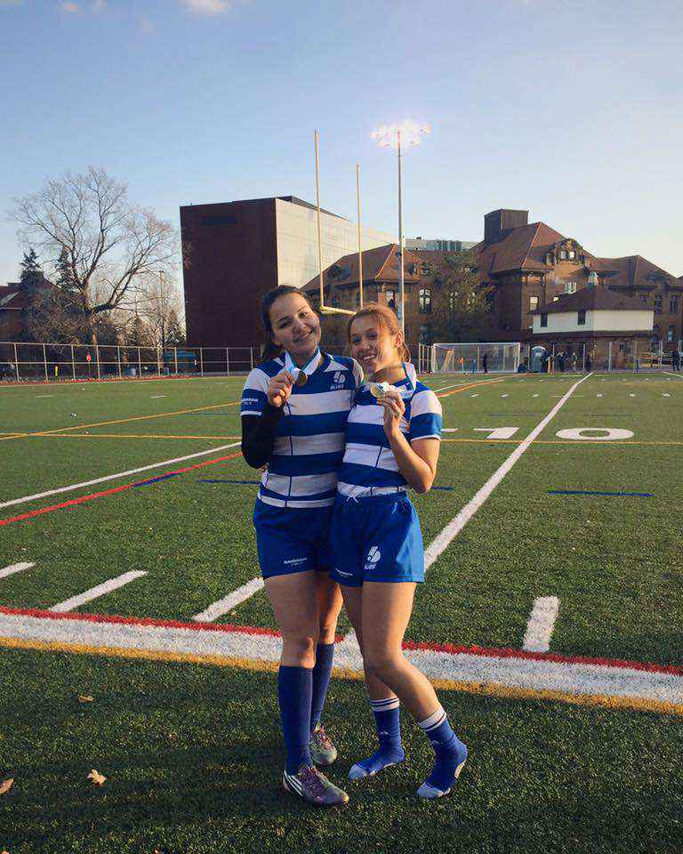 Courtesy Journey Jacobs Cameryn Meloche and Journey Jacobs were forced to watch in anxiety from the sidelines for the second half, while their Dawson Blues rugby squad stole the championship banner from John Abbott.