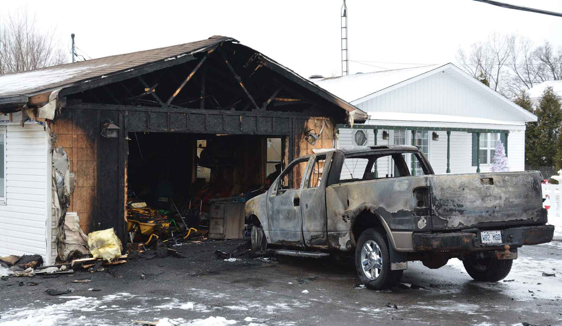 The fire that destroyed Evelyn and Johnny Jacobs' vehicle and garage on January 19 is being investigated by Peacekeepers. (Steve Bonspiel The Eastern Door)