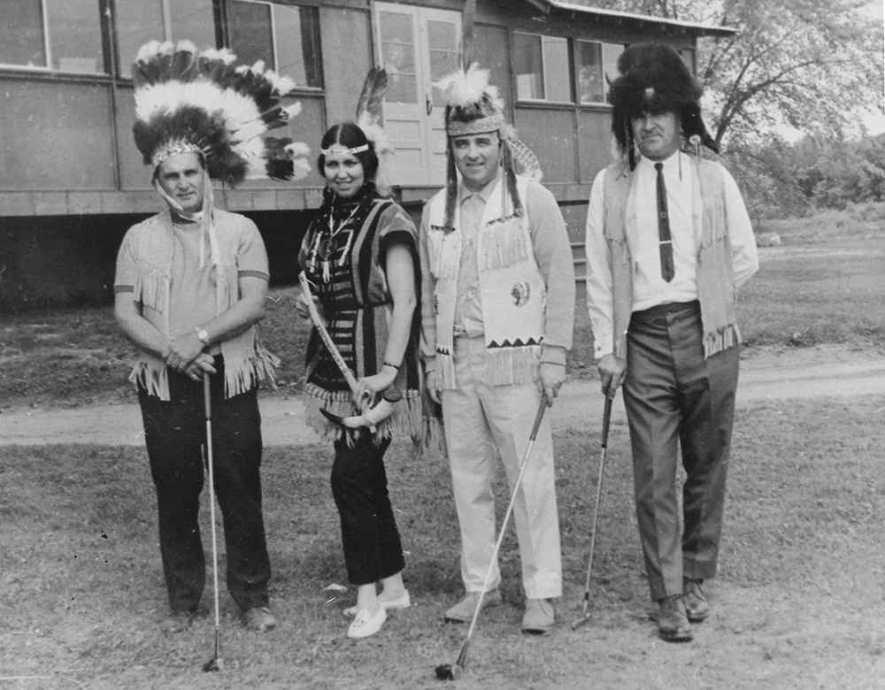 Angus Patton, Gene Eagle, Andrew Delisle and Louis Beauvais stand in front of Caughnawaga's old club house in 1968. (Courtesy Jimmy Patton)