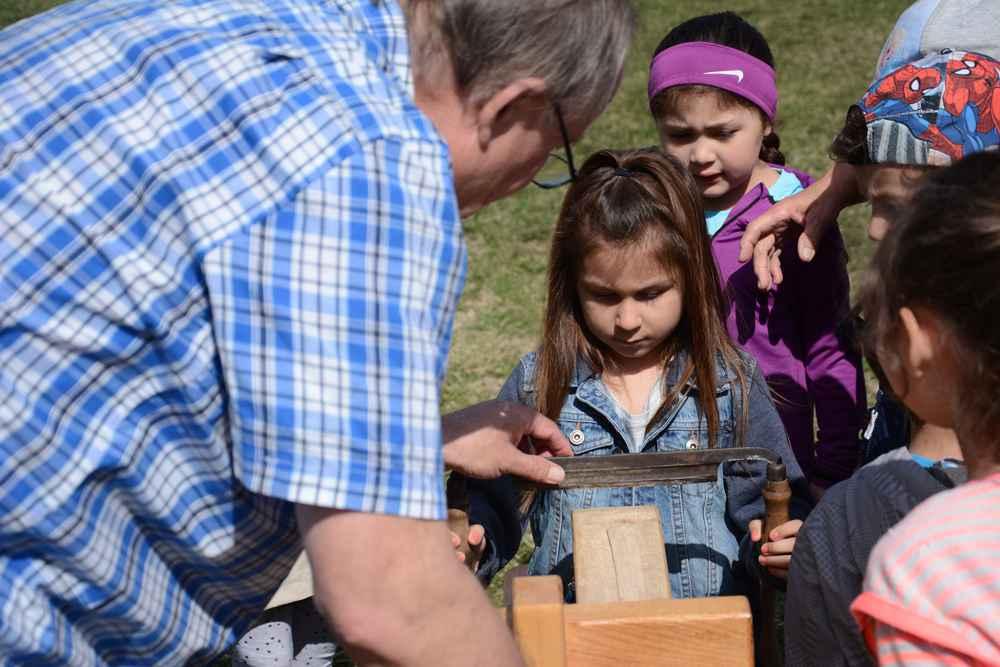 Richard Nolan spent last Thursday teaching students at Karonhianónhna School how to make ash baskets. (Daniel J. Rowe, The Eastern Door)